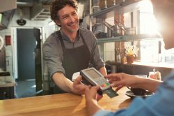 Waiter accepting payment by debit card